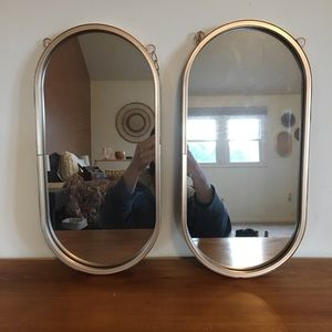 Pair of Champagne Gold Oval Mirrors